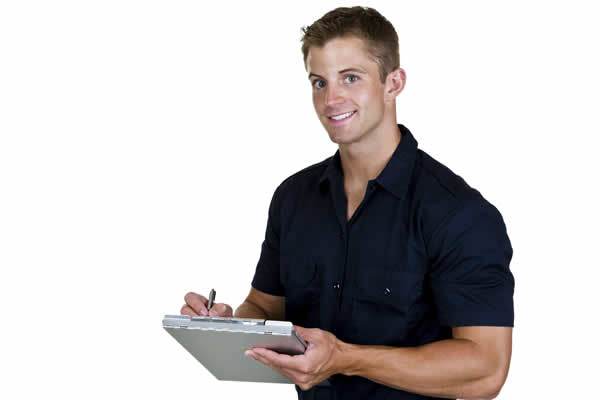 Technician smiling with clipboard